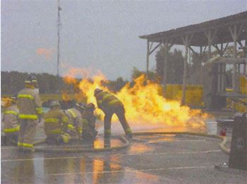 Firefighters Train at the public Safety Facility in extinguishing a propane fire and high angle rescue
