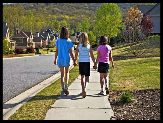 Ashville NC.gov Source Three Girls on sidewalk